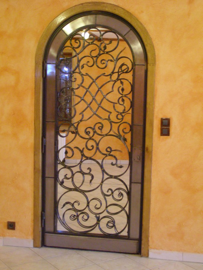 Ferronnerie d 39 art rocle portes grilles de portes et for Porte en fer