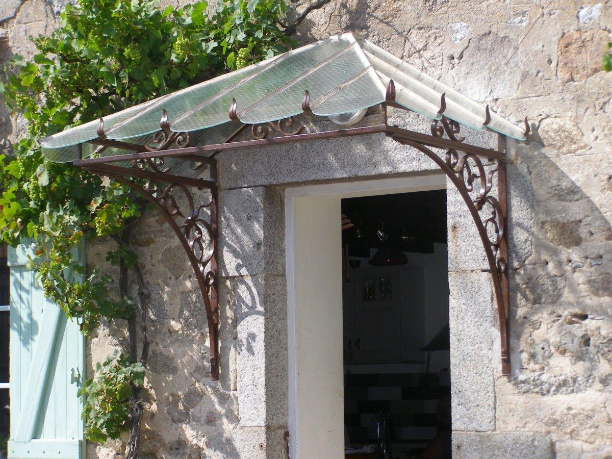 Ferronnerie d 39 art rocle portes grilles de portes et for Model de marquise